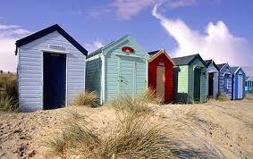 Beach Huts on a sandy hill