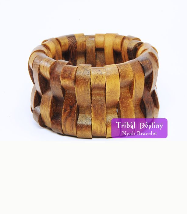 """The Nyah Bracelet (vintage)    Vintage wooden bracelet, circa 1970s. Great condition! Beautiful stretch intricate wood design. Un-stretched size is 2.5"""" wide, stretches to about 4"""".  No stains. Beautiful accessory.  $27  http://www.tribaldestiny.com/product/nyah-bracelet"""