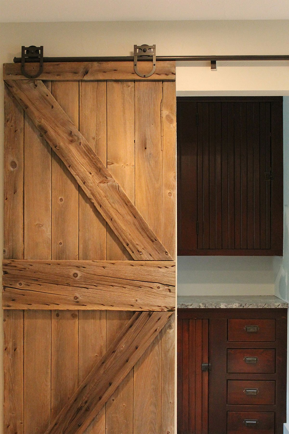 Repurposed barn door and cabinetry from an early 1900s farmhouse