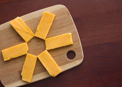 Ersatz 2 Unzen Cheddar-Käse für eine Tasse Hüttenkäse.