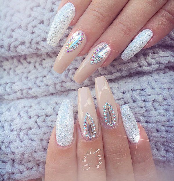 Since coffin nails are longer, it would give you more freedom for designing with diamonds. Here, you can see tear-shaped diamonds surrounded by tiny ones. And it still leaves enough space so it won't look crowded.