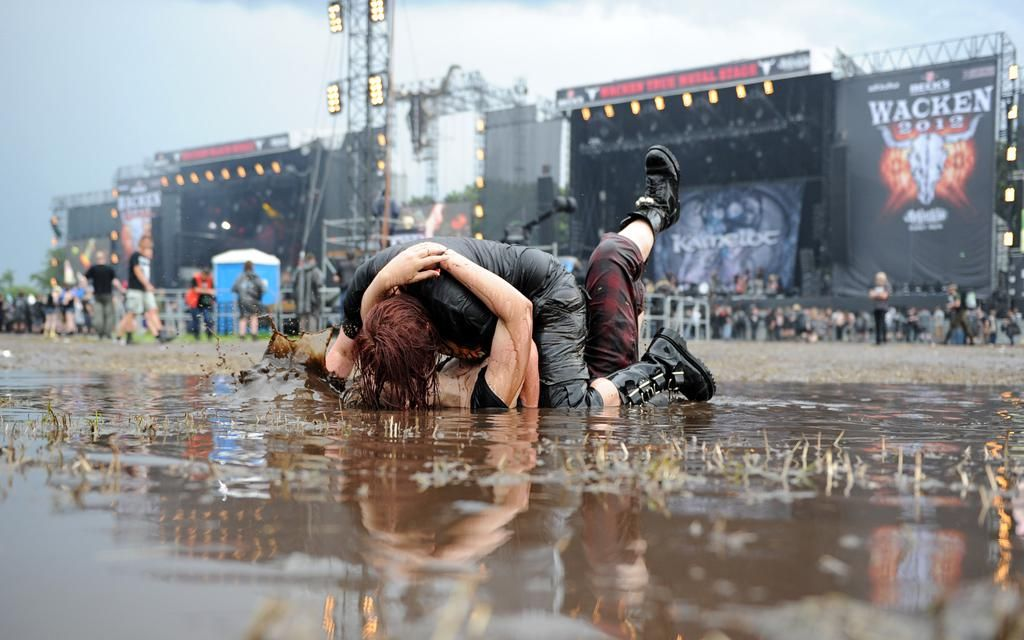 Couple kissing at world's largest Metal festival. Wacken, Germany