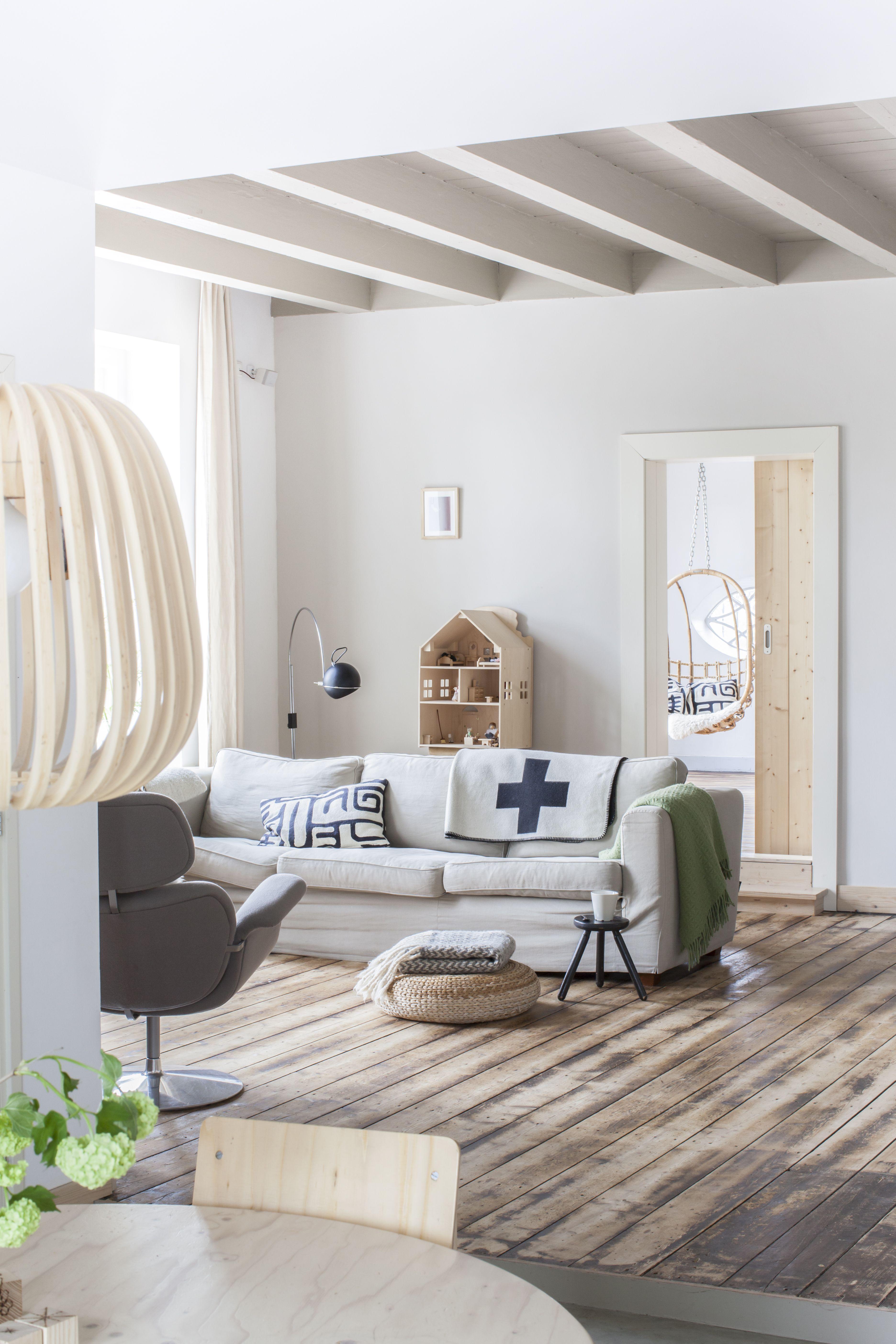 interesting neutral living room decor  mock wood floor