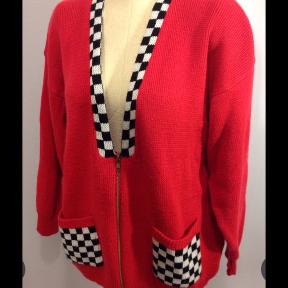 Vintage Checkered Flag Red Sweater Super cute and trendy vintage sweater. Zip front w/ 2 pockets. Small hole on back , shown in pic. Price reflects flaw. Otherwise great condition! Bristol Court Sweaters Cardigans