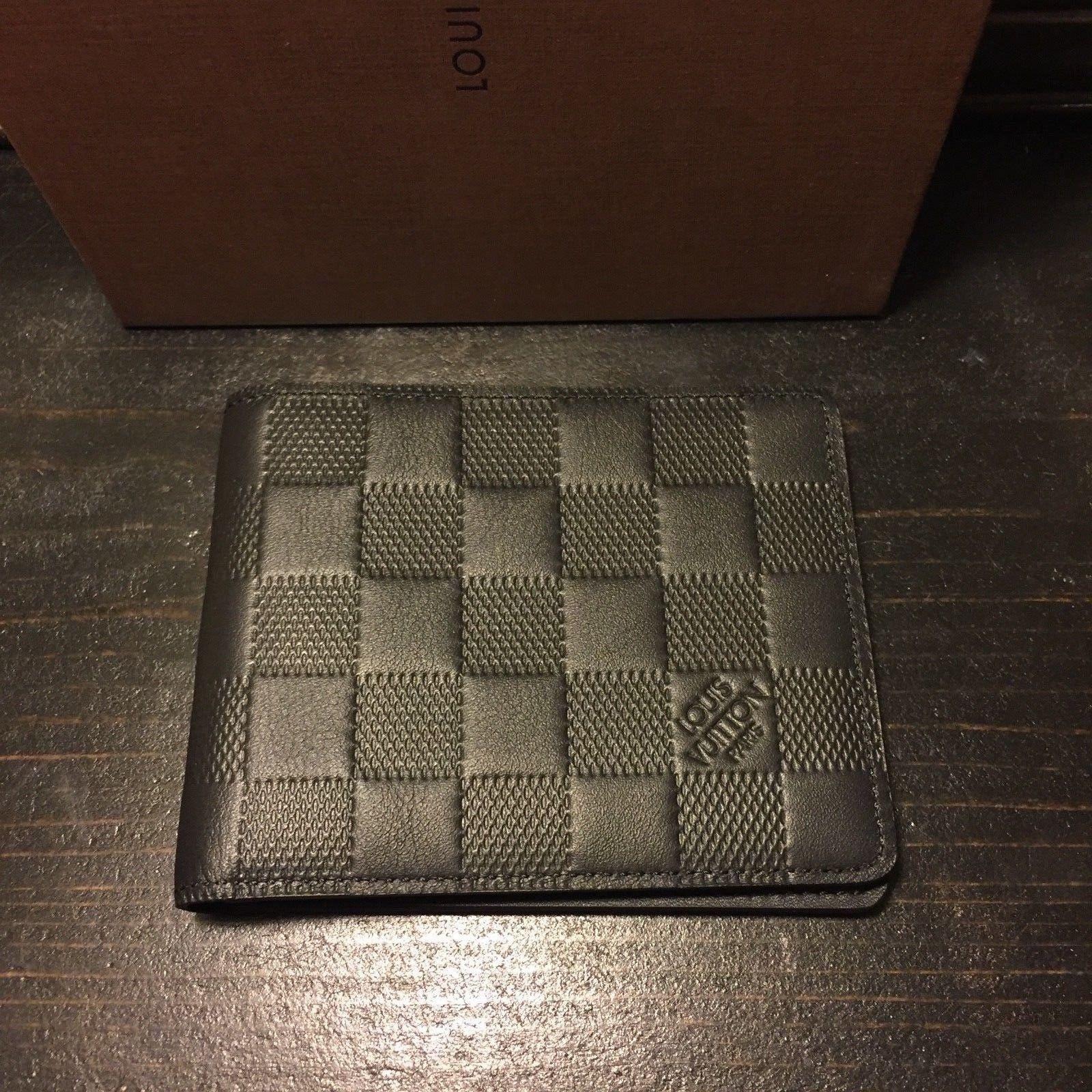 bf8c3980a18 100% Authentic Louis Vuitton Slender Wallet for Men Black Damier ...