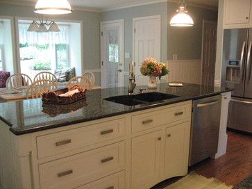 Cream Cabinets With Uba Tuba Granite Traditional Kitchen By San