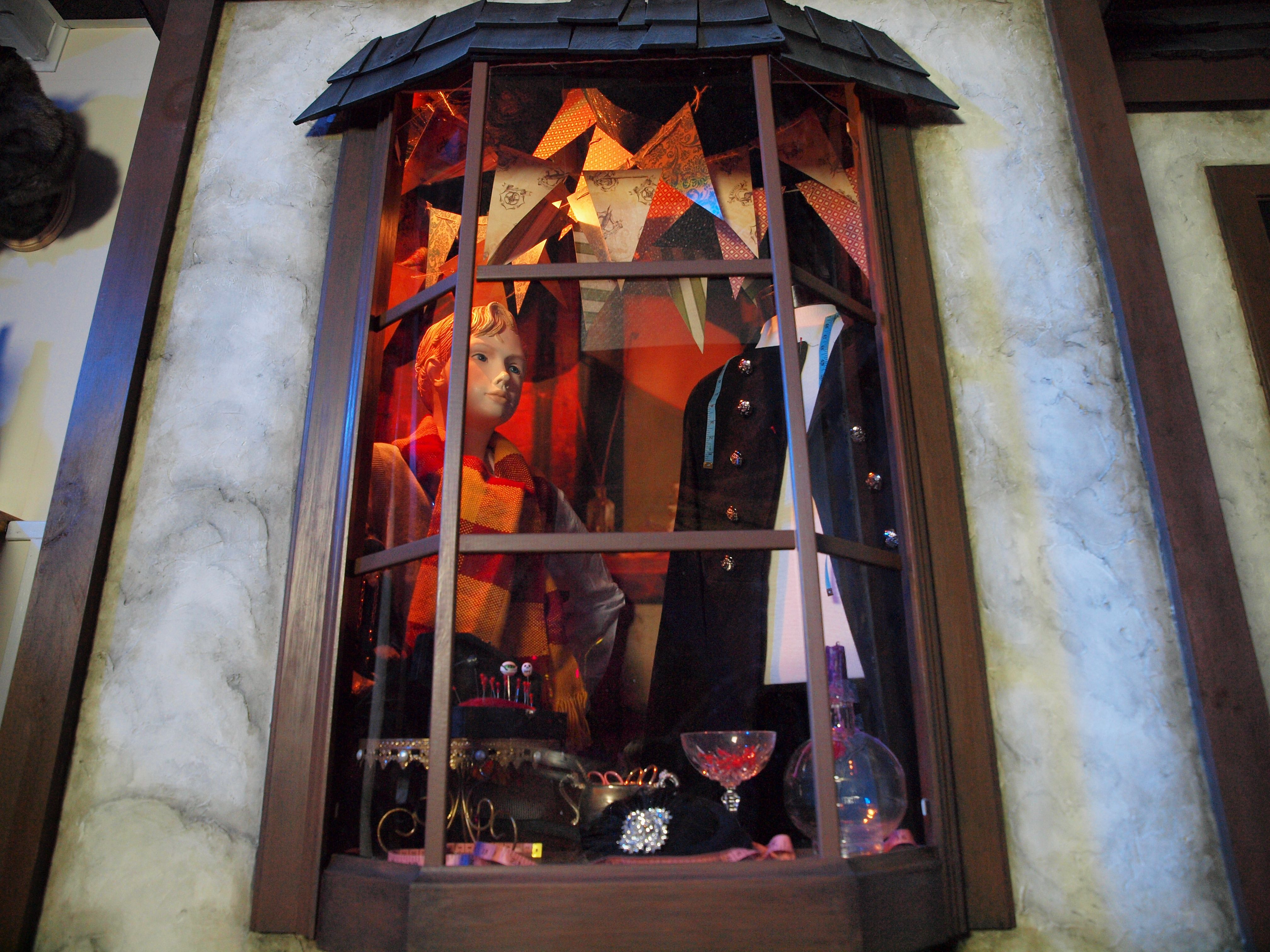 Twilfitt & Tattings Window in our basement bar | Harry Potter Bar ...