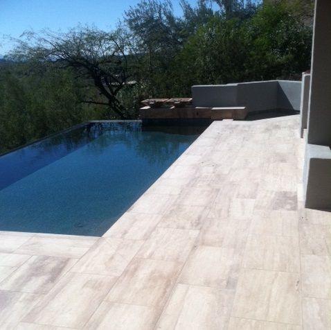 espresso vein-cut marble limestone tile creates a modern look for