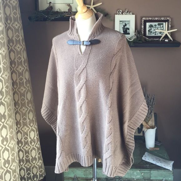 Liz Claiborne Taupe Cable Knit Poncho This is a new without tags/ unworn poncho from the Liz Claiborne Petites Line, size L/ XL. It's a nice longer length and would hit at the hip naturally on anyone. Beautiful mushroom griege or taupe color with cute faux leather and silver buckle at the V-neck. Composition: 40% acrylic, 35% polyester, 25% wool. Liz Claiborne Sweaters Shrugs & Ponchos