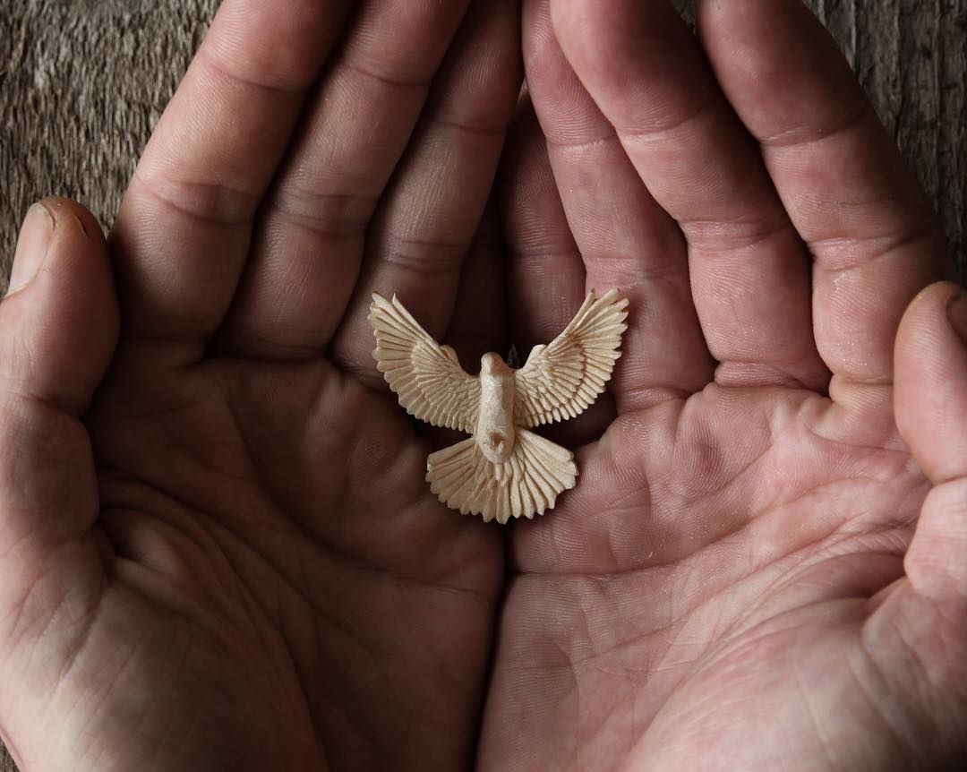 Dove pendant hand carved by knife from sycamore wood by giles