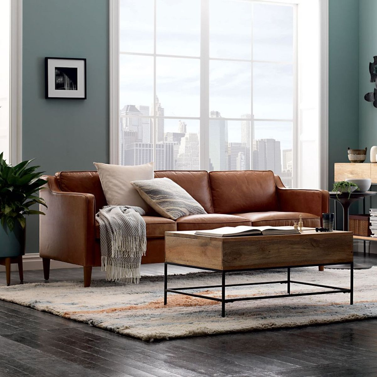 Brown Leather Sofa As The Center Piece Of This Living Room Design
