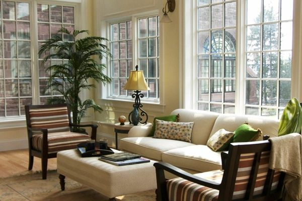 Classic Style White Sunroom Design With Soft Sofa And Antique Table Lamp That Have Metal Legs Also Corner Indoor Plant In The Pot For Small Interior