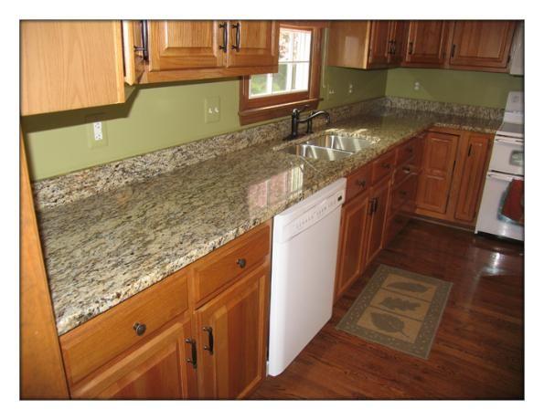 Santa Cecilia granite + maple cabinets. I like the wall ... on Granite With Maple Cabinets  id=60270