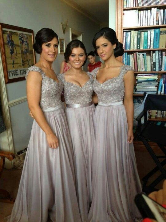 love these silver bridesmaids dresses! So pretty especially the beaded top and cap sleeves!