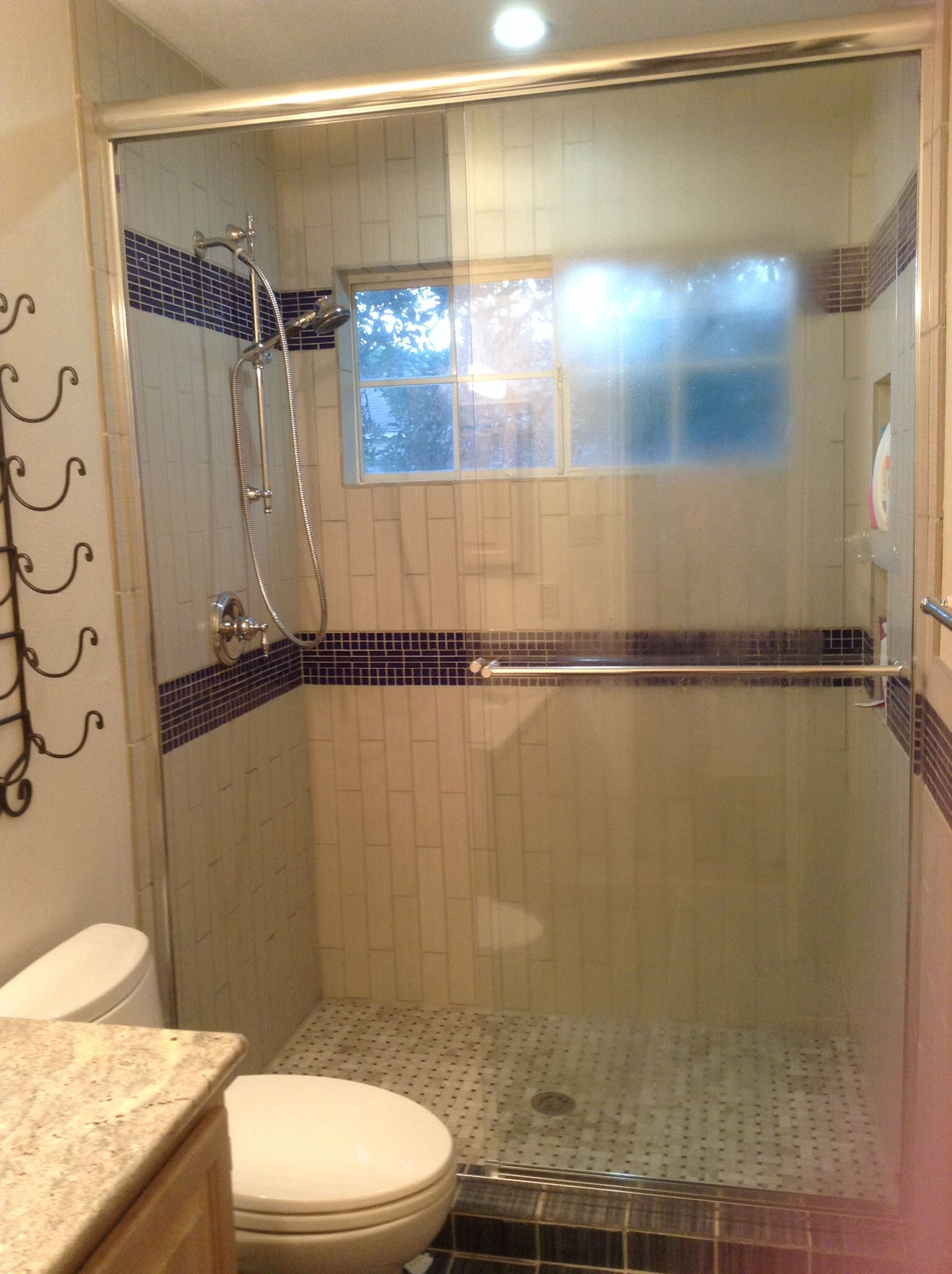 Converted our old bathtub into a stand up shower with subway tiles ...