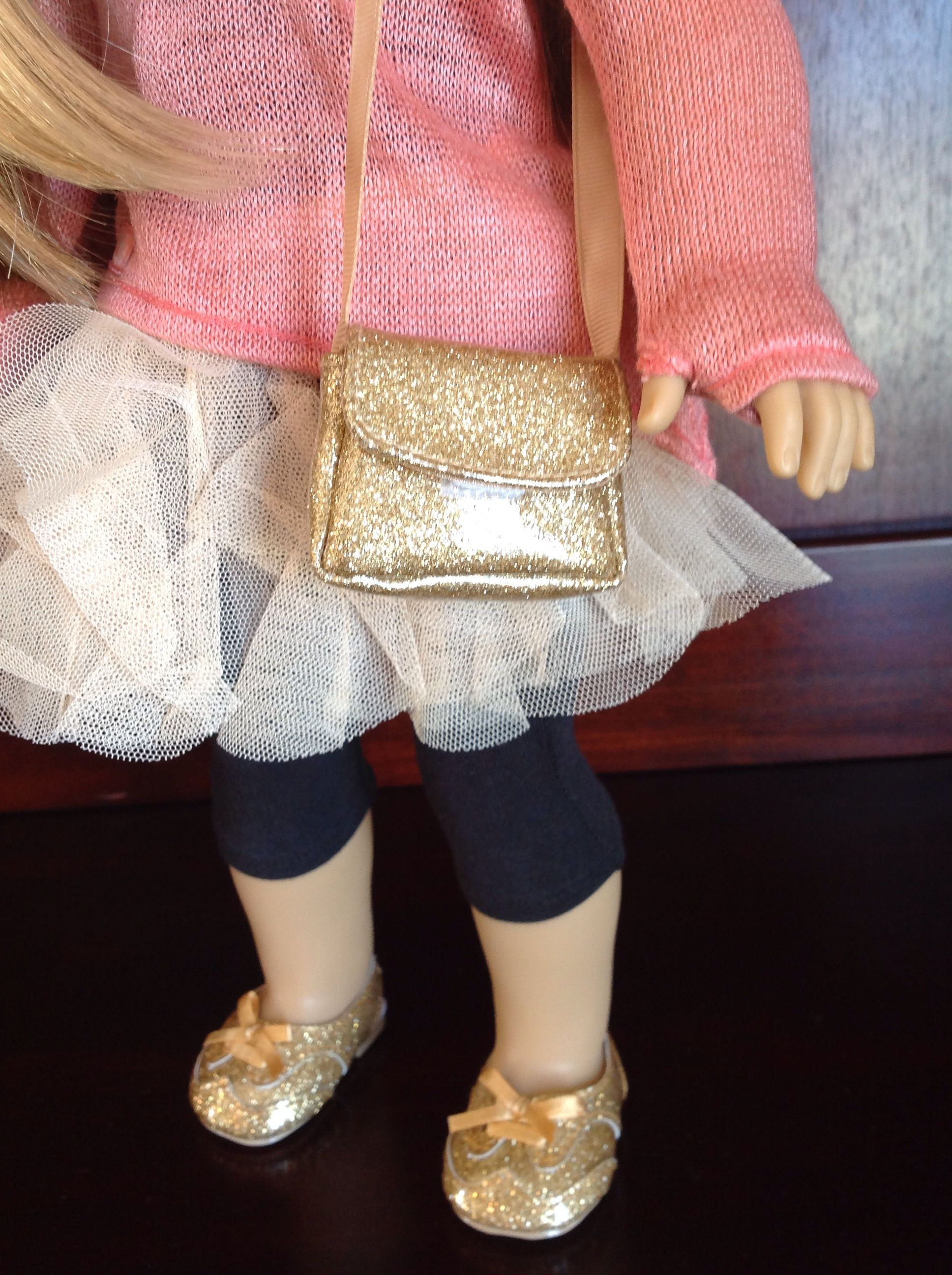 American Girl Isabelle wearing gold purse and meet shoes