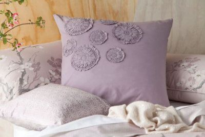 Sayuri Continental Cotton Pillow Case. The Sayuri soft cotton continental pillowcases feature gathered and stitched floating flowers.