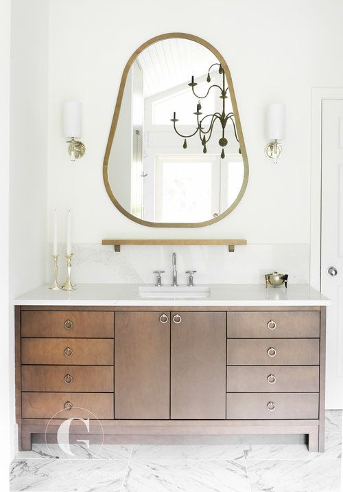 A Chocolate Brown Vanity Is Adorned