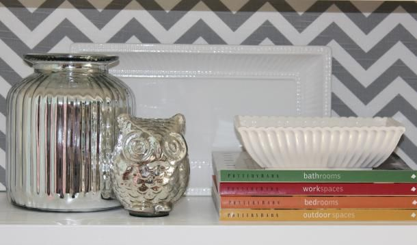 I have a bookcase that I can't seem to nail...maybe these tips will help.  Making bookcases work: symmetry, bold uses of colour, accessory layering
