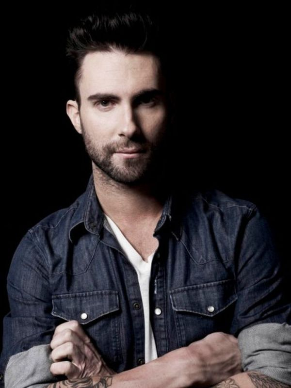 Ok..I'd admit I am not attracted to a man who has alot of tatoos but there is something about Adam Lavine.  His eyes and his voice