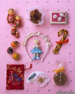 'The Nutcracker'-Themed Stocking for Girls: 1. Russian nesting dolls 2. Sophisticated pates des fruits are sugarplums celebrated by the Fairy. 3. Tea Dance tea set. 4. Marzipan fruits recall the Marzipan Dance. 5. A Clara doll pirouettes through a headband of flowers. 6. Candy Canes. 7. Arabian-like jewels in a Chinese-style pouch. 8. Waltzing with flowers in your hair. 9. Gingersnaps honor Mother Ginger, the dancer with children beneath her.
