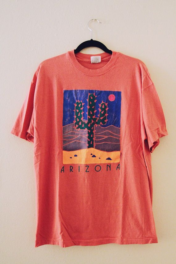 6466d675 90s Arizona t-shirt has a neon, perfectly cracked graphic. Made in USA.  Printed size: XL Shoulders: 22 Chest: 23 Length: 29 >>vintage condition<<  Vintage ...