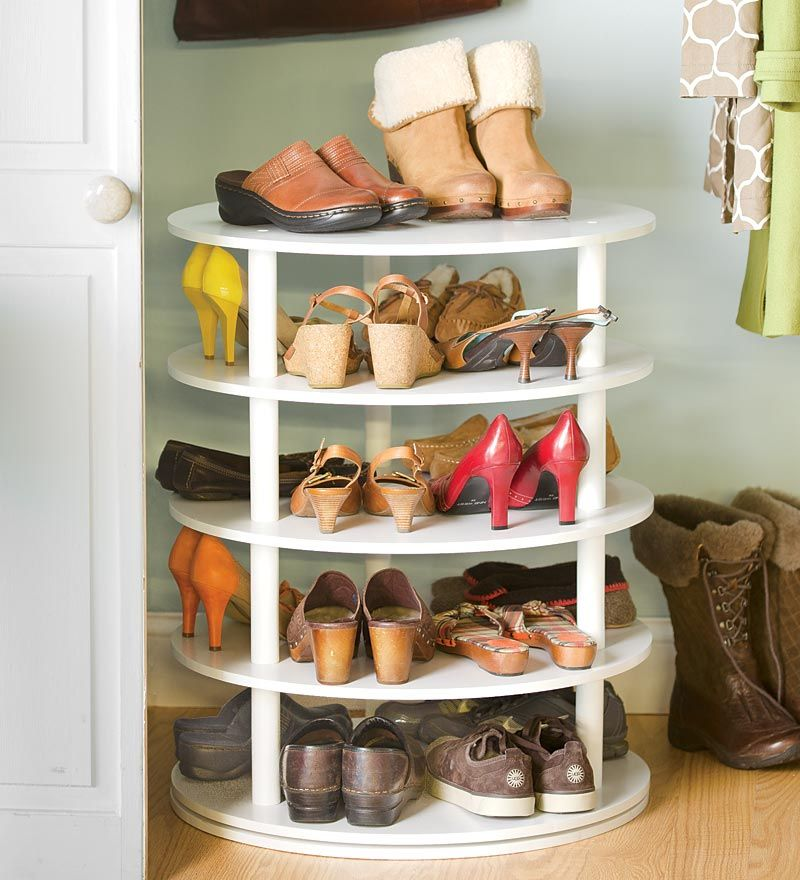 rotating fivetier shoe rack holds pairs of shoes in a compact