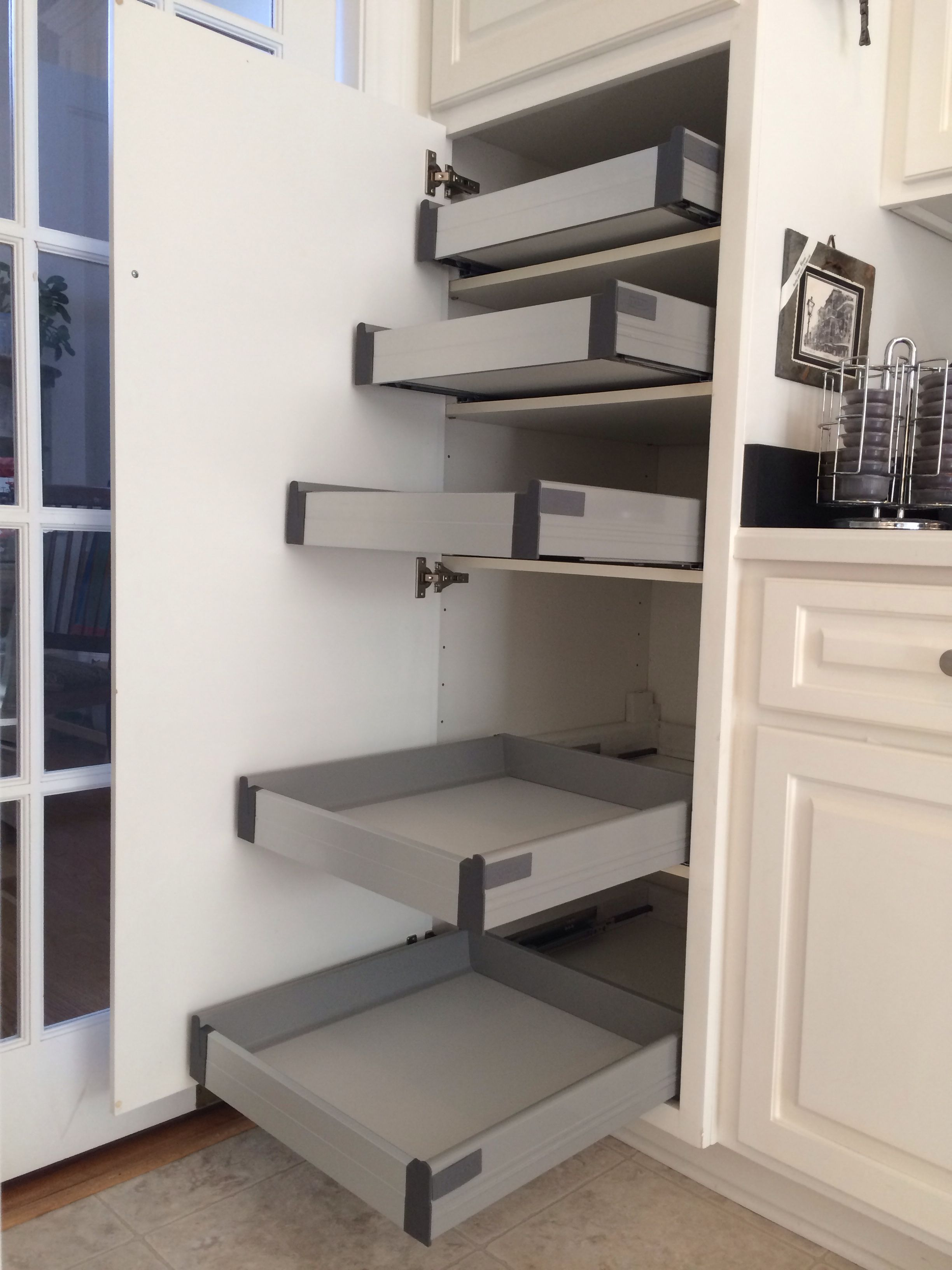 IKEA Rationell pull-out shelves (w/ dampers) retrofitted to non-IKEA cabinet  pantry using existing shelves.