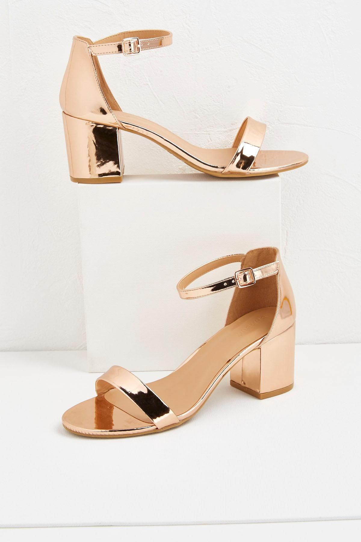 97c9c60920f These trendy heels feature low block heels and skinny ankle straps for a  chic look.  versona  myversonastyle  shopversona  metallics  fall