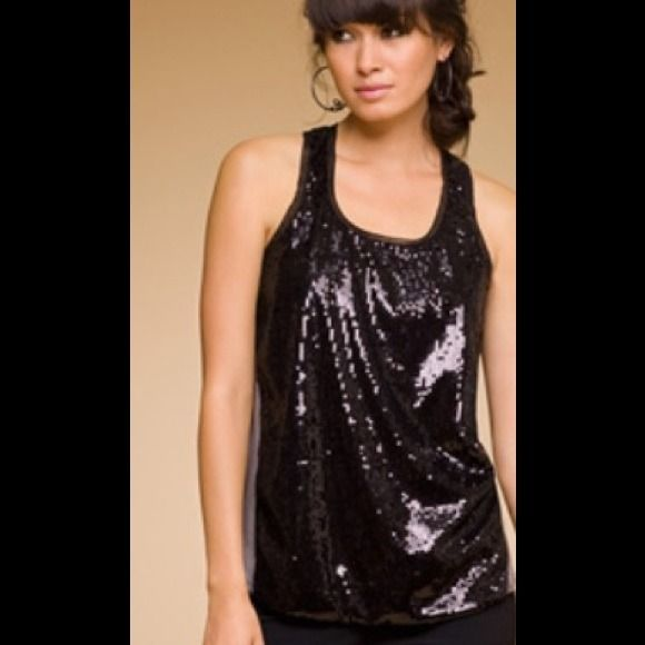 Reduced! Rachel Roy sparkly tank top Great for night out! Super comfy and sexy, has a great flow to it. Would look great with leggings or jeans Rachel Roy Tops Tank Tops