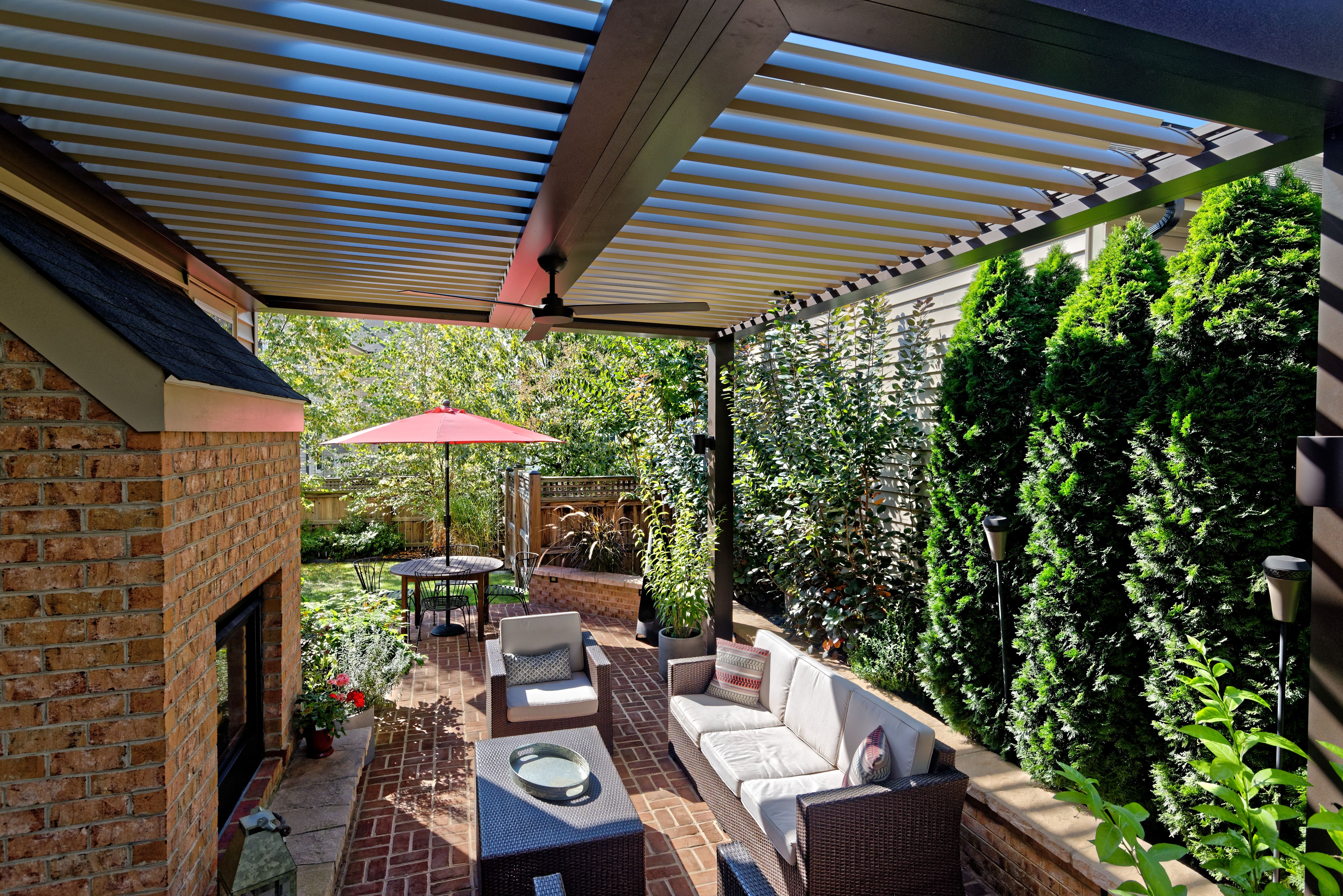 This patio provides the best of outdoor living with an Equinox ... on blue roof, motorized roof, patio roof, pergola sun shade roof, outdoor kitchen with metal roof, eclipse opening roof, solar shingles roof, icf roof,