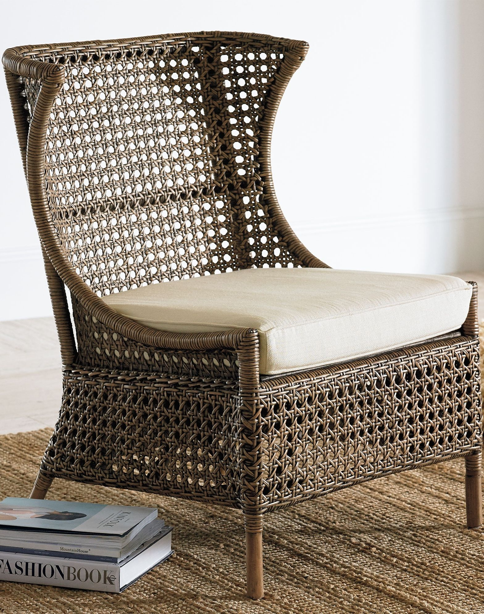 Two stylish highback rattan chairs delight with two
