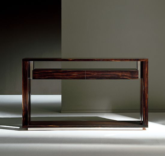 designer console tables. rare editorial macassar ebony console tables with polished steel detailing. part of an extensive range designer furniture design. p