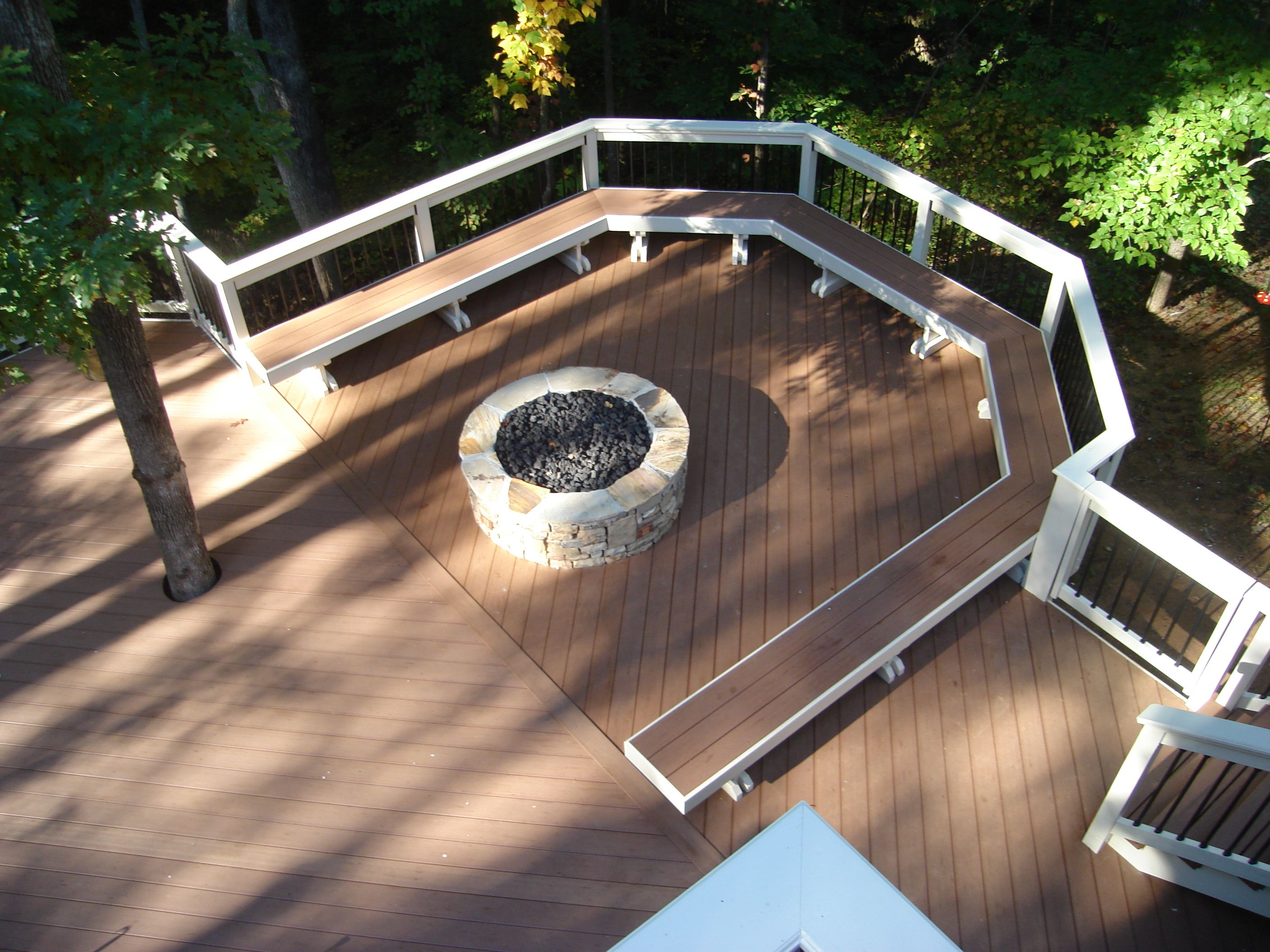Metal fire pit on wood deck - Timber Tech Composite Deck With Curved Bench And Fire Pit In Beavercreek Ohio Greene County