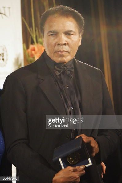 Boxing legend Muhammad Ali holds the Otto Hahn Peace Medal during the award presentation on December 17 2005 in Berlin Germany Ali is receiving the...