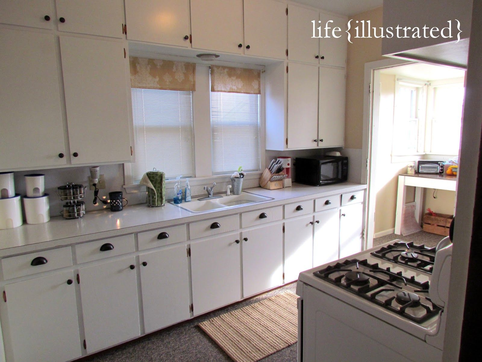 flat cabinets painted in white enamel kitchen makeover