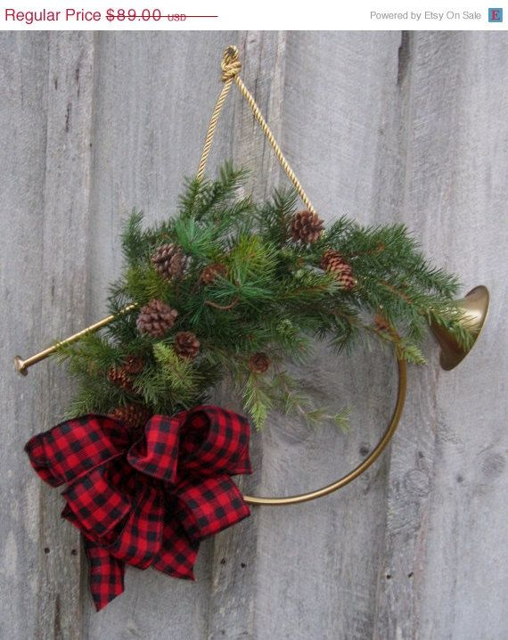 An antique gold vintage French horn makes a simple but elegant and festive door decoration.