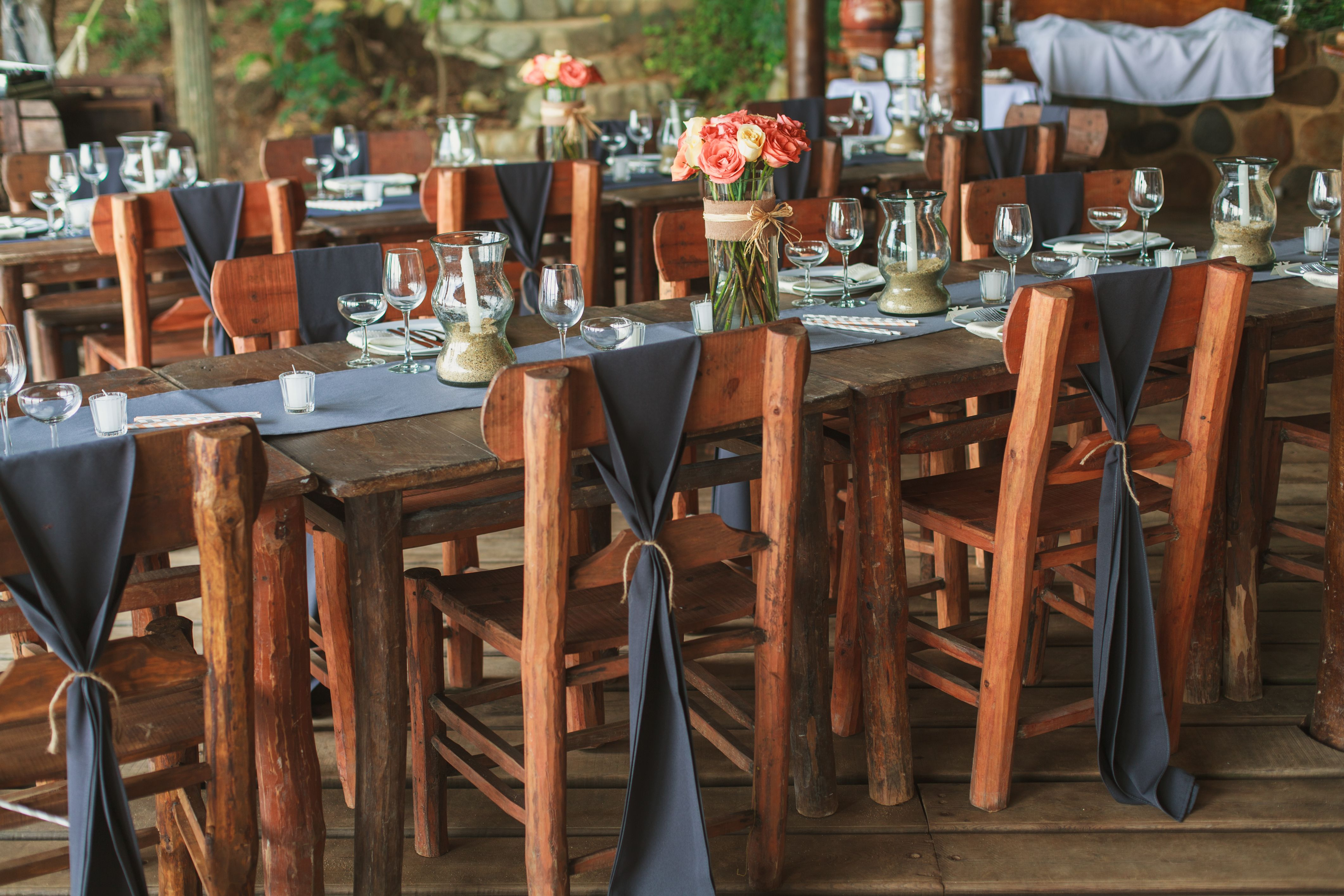Rustic style, exposed wooden tables and chair bows