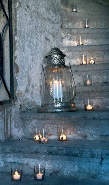 Love the old spiral staircase with the candles