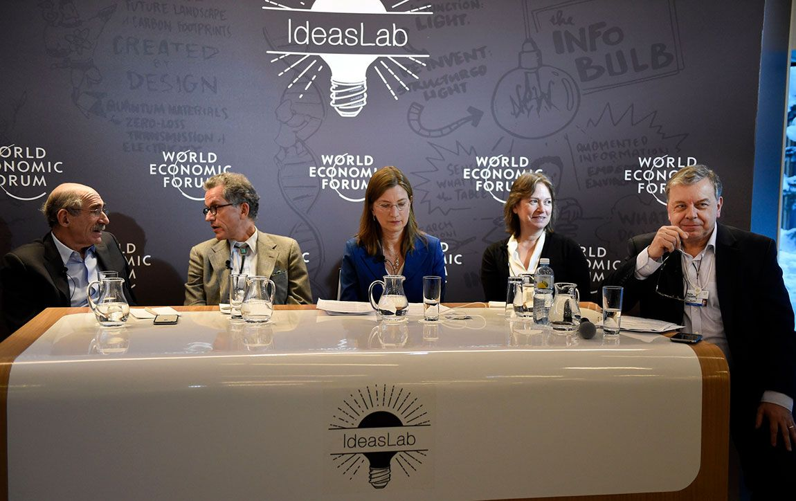 """Princeton professors Michael Oppenheimer (left to right) and Guy Nordenson confer as Professor Denise Mauzerall, engineering Dean Emily Carter and panel moderator Philip Campbell, editor-in-chief of the journal Nature, ready for discussion at an """"Ideas Lab"""" panel and workshop on climate change."""