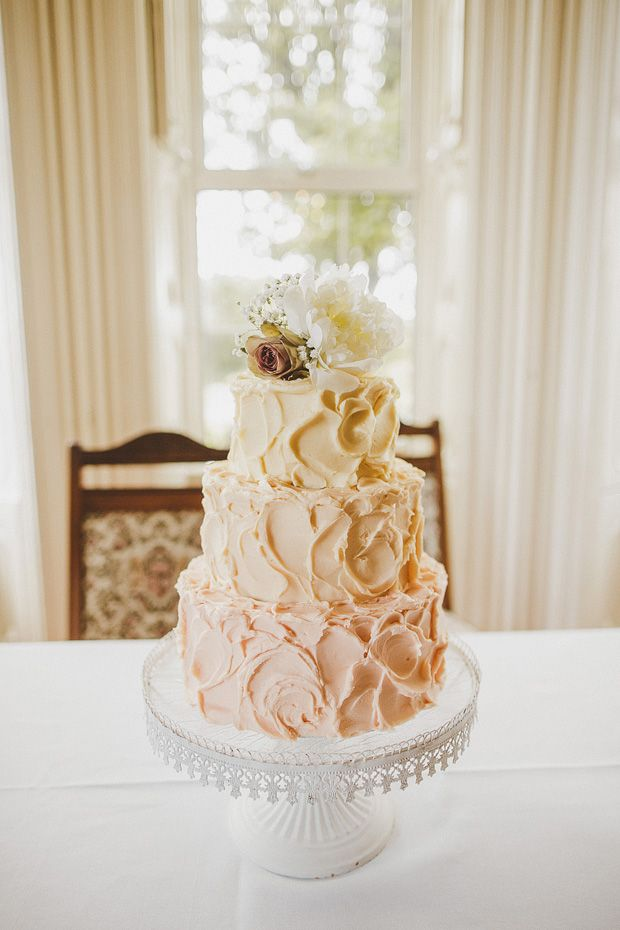 cream wedding cake with flower detail - Read more on One Fab Day: http://onefabday.com/ballintaggart-house-wedding-by-ed-peers/
