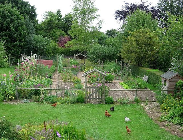 Country vegetable garden with well-designed pair of gates