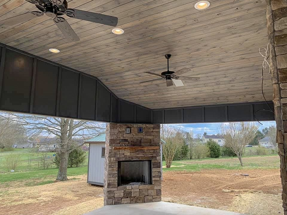 This Back Patio Is Unbelievably Huge With Wood Tongue Groove Ceilings Wood Burning Fireplace With Gas Starter Bui Back Patio Wood Burning Fireplace Patio