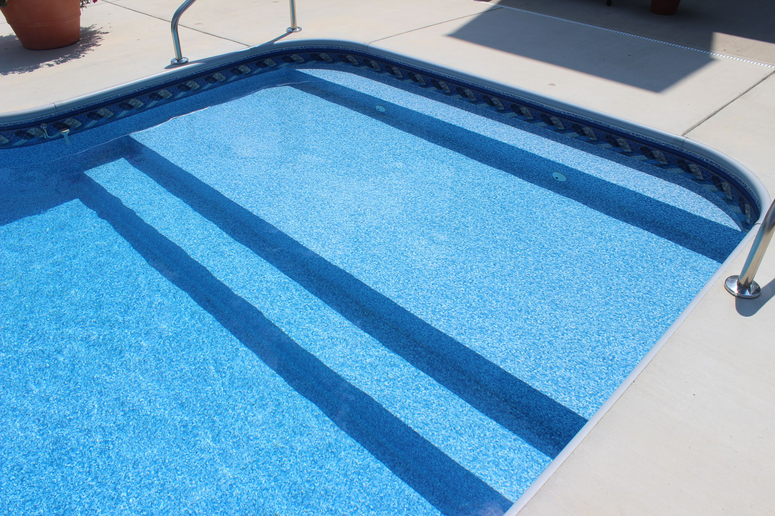 In ground vinyl liner swimming pool with full width steps for Above ground pool decks indianapolis