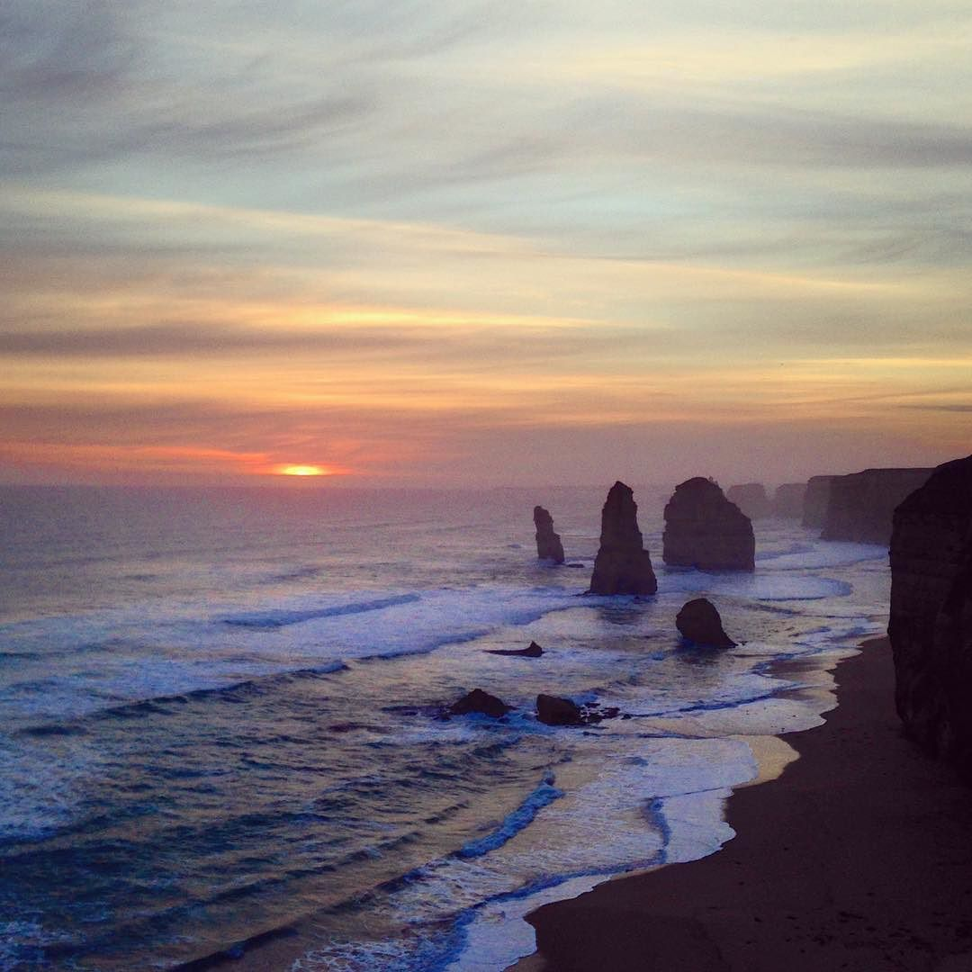 After an amazing day of driving down the famous Great Ocean Road this was how we saw the sun go down   The world famous 12 Apostles at sunset - rammed with tourists but b-e-a-utiful all the same   Could not ask for a better first Aussie road trip or better company now let's find some goon!  #WhereIsIz #12Apostles #Victoria #GreatOceanRoad #Aus #sightseeing #sunset #cloudscape #roadtrip #exploring #GOR #ocean #defensivedriving #Kia #dreamy #wanderlust #Instatravel by whereisiz…