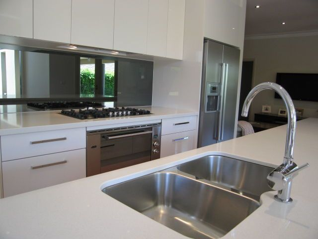 Kitchen Gloss White Handleless Cabinets And Drawers Tinted