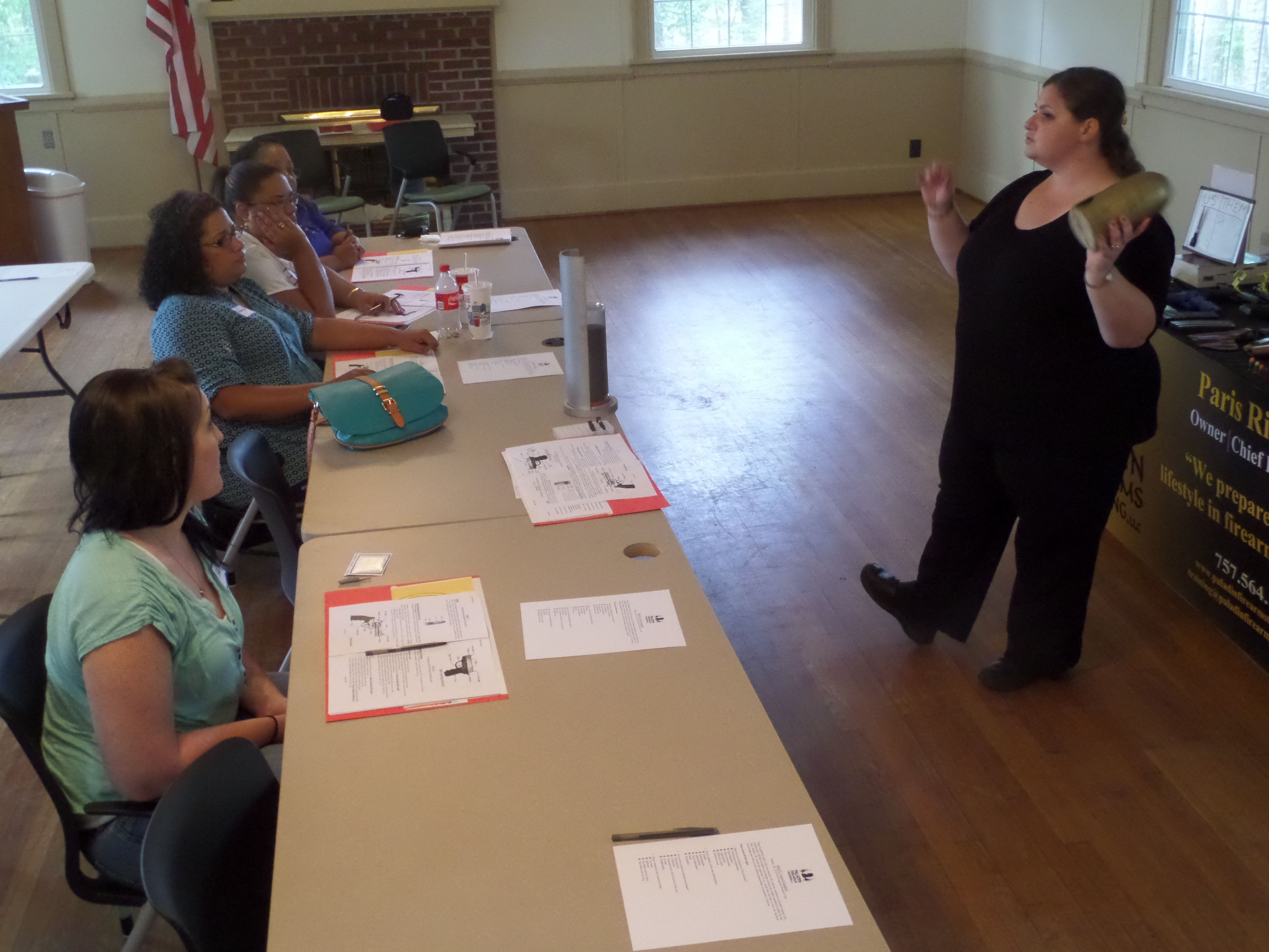 Assistant Instructor Rilveria explaining caliber of a
