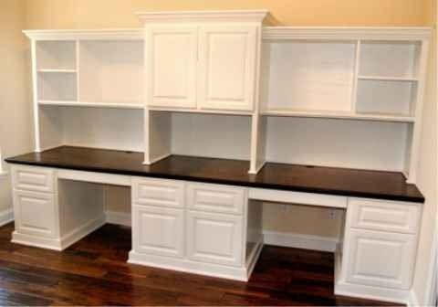 custom built office desk. custom built office desk with two work areas also has oversized file drawers and storage for equipment in wire management i