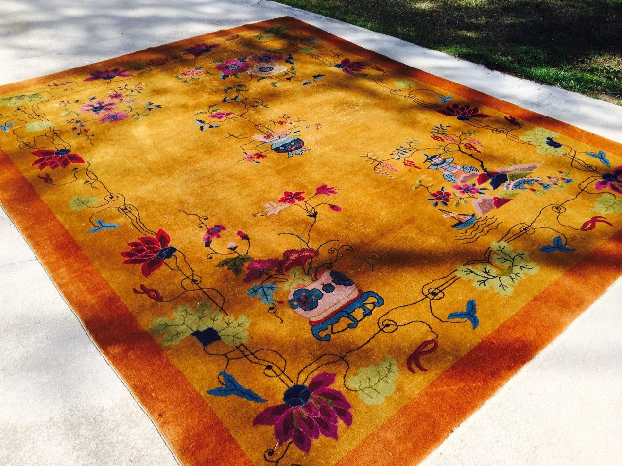 Here is a beautiful 1920's-30's art deco Chinese carpet in the 9'x 12' size range. It has scattered wear down to the foundation in three area's, but other than that, this carpet is as tough as it is b