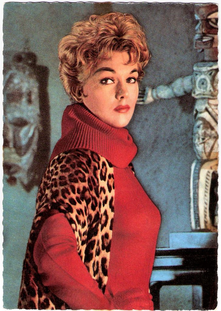 https://flic.kr/p/BmFyZ2 | Kim Novak | German postcard by Ufa, Berlin-Tempelhof, no. CK 280. Photo: Terb Agency.  American film and television actress Kim Novak (1933) starred in such popular successes as Picnic (1955), The Man with the Golden Arm (1955) and Pal Joey (1957). However, she is perhaps best known today for her 'dual role' as both Judy Barton and Madeleine Elster in Alfred Hitchcock's classic thriller Vertigo (1958). She withdrew from acting in 1966, and has only sporadically…